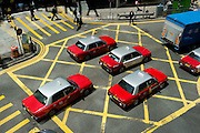 HONG KONG - APRIL 14: Taxis in Central business district, on April 14, in Hong Kong. (Photo by Lucas Schifres/Pictobank)