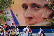 "Close-up of Team GB Olympic cycling champion Bradley Wiggins on a large TV screen during the London 2012 Olympics. Wiggins has become a hero for Britons with 'Wiggo's'"" victory in the time trial the previous day. This land was transformed to become a 2.5 Sq Km sporting complex, once industrial businesses and now the venue of eight venues including the main arena, Aquatics Centre and Velodrome plus the athletes' Olympic Village. After the Olympics, the park is to be known as Queen Elizabeth Olympic Park."