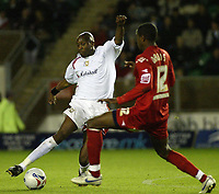 Photo: Marc Atkins.<br /> Milton Keynes Dons v Peterborough United. Coca Cola League 2. 06/10/2006.<br /> <br /> Drissa Diallo (L) of MK Dons goes past Liam Davis.