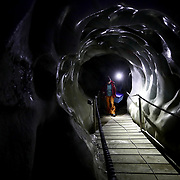 Glaciologist Andrea Fischer and Environmental Physicist Pascal Bohleber, from the Austrian Institute for Interdisciplinary Mountain Research, carry a box inside the artificial ice tunnel of Schaufelferner glacier at Stubaier glacier ski resort near Neustift im Stubaital, Austria, October 22, 2018. REUTERS/Lisi Niesner