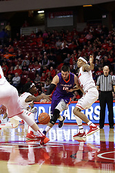 15 January 2016: Mislav Brzoja(10) works his way past DeVaughn Akoon-Purcell(44) but Paris Lee(1) swipes at the ball during the Illinois State Redbirds v Evansville Purple Aces at Redbird Arena in Normal Illinois (Photo by Alan Look)