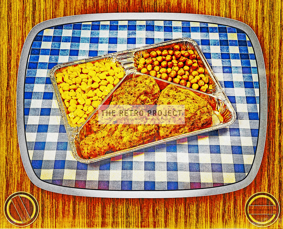 Aged TV Dinner Meal on Chequered blue background with wood surround and television screen
