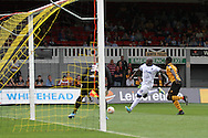 Adebayo Akinfenwa of Wimbledon (c) shoots at goal. Skybet football league two match, Newport county v AFC Wimbledon at Rodney Parade in Newport, South Wales on Saturday 27th Sept 2014<br /> pic by Mark Hawkins, Andrew Orchard sports photography.