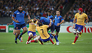 Bernard Le Roux (France) getting tackled by Viorel Lucaci (Romania) during the Rugby World Cup Pool D match between France and Romania at the Queen Elizabeth II Olympic Park, London, United Kingdom on 23 September 2015. Photo by Matthew Redman.