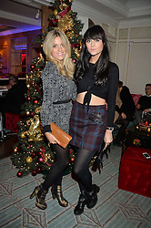 Left to right, OLIVIA COX and LILAH PARSONS at the Fortnum & Mason and Quintessentially Foundation Fayre of St.James's in association with The Crown Estate held at St.James's Church, Piccadilly followed but a reception at Fortnum & Mason, Piccadilly,London on 5th December 2013.