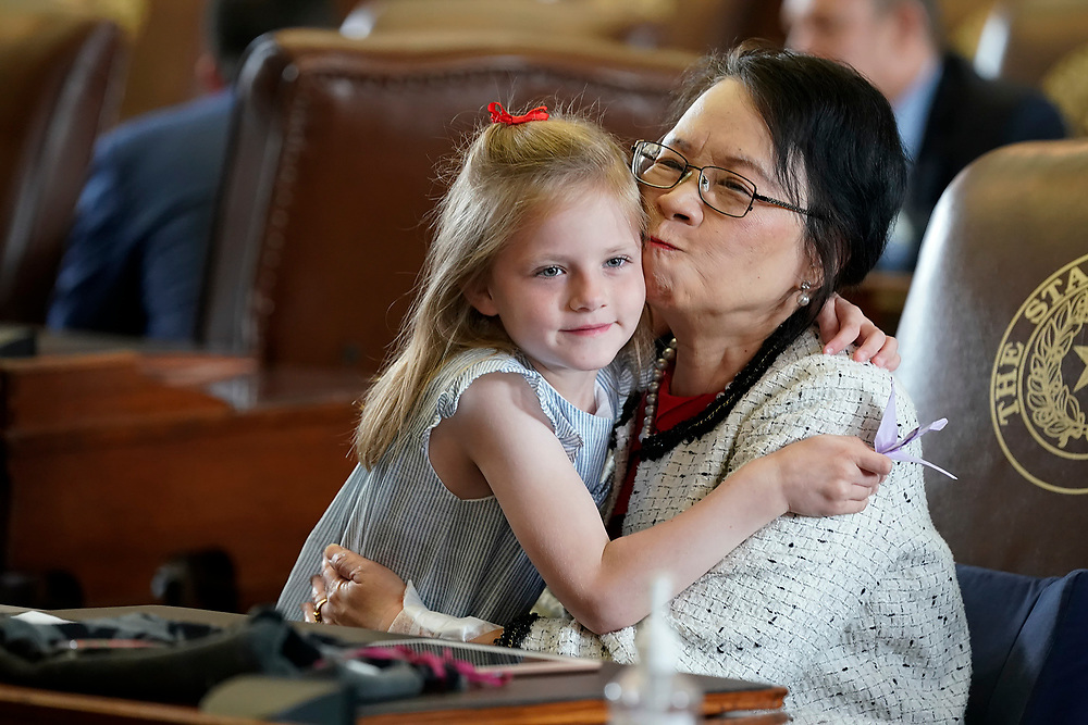 Hollis Rose Landgraf, daughter of Rep. Brooks Landgraf of Odessa, gives a hugh to Rep. Angie Chen Button, R-Dallas, on the final day of the 87th Texas Legislature.