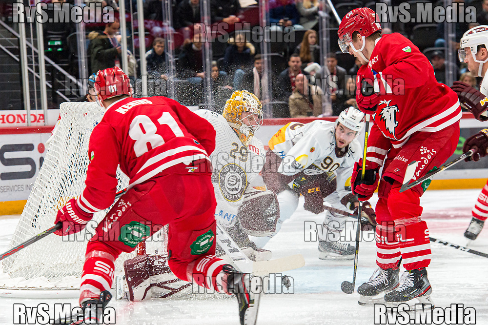 LAUSANNE, SWITZERLAND - NOVEMBER 23: #80 Robin Leone of Lausanne HC tries to score against #29 Goalie Robert Mayer of Geneve-Servette HC during the Swiss National League game between Lausanne HC and Geneve-Servette HC at Vaudoise Arena on November 23, 2019 in Lausanne, Switzerland. (Photo by Robert Hradil/RvS.Media)