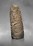 Late European Neolithic prehistoric Menhir standing stone with carvings on its face side. The representation of a stylalised male figure starts at the top with a long nose from which 2 eyebrows arch around the top of the stone. below this is a carving of a falling figure with head at the bottom and 2 curved arms encircling a body above. Excavated from Paule Luturru,  Samugheo. Menhir Museum, Museo della Statuaria Prehistorica in Sardegna, Museum of Prehoistoric Sardinian Statues, Palazzo Aymerich, Laconi, Sardinia, Italy .<br /> <br /> Visit our PREHISTORIC PLACES PHOTO COLLECTIONS for more photos to download or buy as prints https://funkystock.photoshelter.com/gallery-collection/Prehistoric-Neolithic-Sites-Art-Artefacts-Pictures-Photos/C0000tfxw63zrUT4
