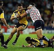 Tamati Ellison tackled by Al Baxter<br />Super 14 rugby union match, Waratahs vs Hurricanes, Sydney, Australia. <br />Saturday 14 May 2010. Photo: Paul Seiser/PHOTOSPORT
