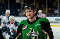 KELOWNA, CANADA - JANUARY 19: Ozzy Wiesblatt #19 of the Prince Albert Raiders stands at the bench during warm up against the Kelowna Rockets on January 19, 2019 at Prospera Place in Kelowna, British Columbia, Canada.  (Photo by Marissa Baecker/Shoot the Breeze)