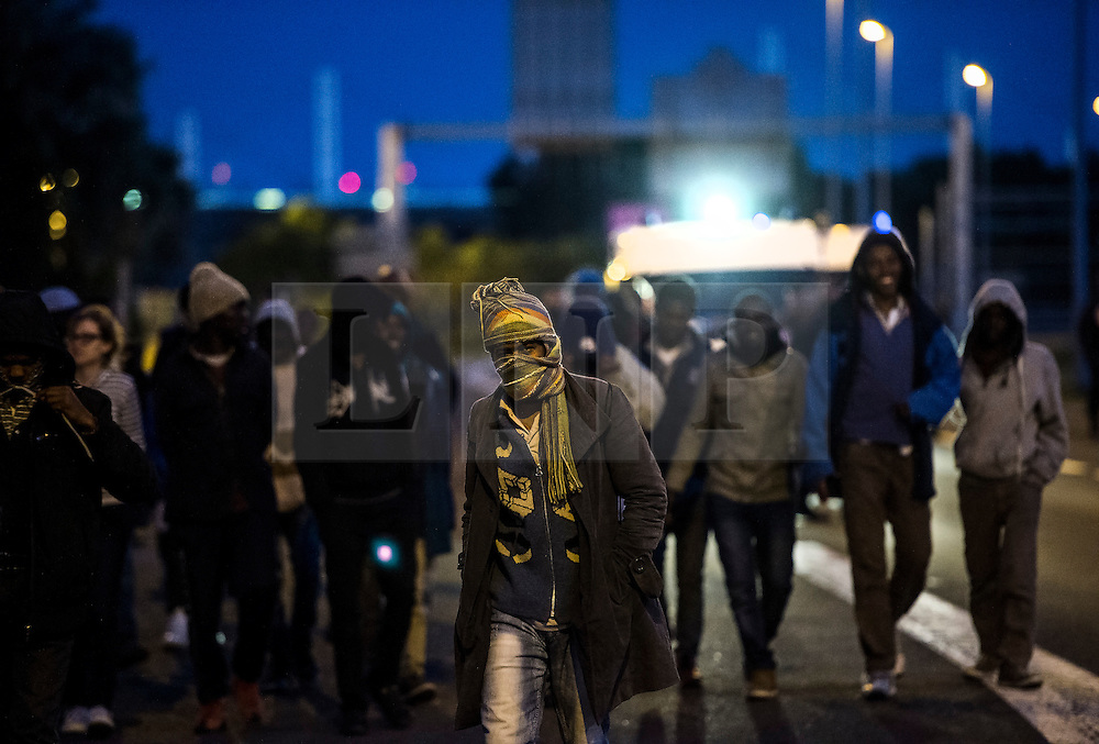 © London News Pictures. Calais, France. Immigrants attempting to reach the UK via the Eurotunnel at Calais in France. The situation has reached crisis point, which French police over run by attempts to cross the border. Photo credit: Ben Cawthra /LNP