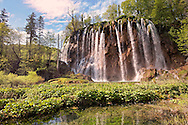 Waterfall over the travatine deposits of Plitvice. Plitvice ( Plitvika ) Lakes National Park, Croatia. A UNESCO World Heritage Site .<br /> <br /> Visit our CROATIA HISTORIC SITES PHOTO COLLECTIONS for more photos to download or buy as wall art prints https://funkystock.photoshelter.com/gallery-collection/Pictures-Images-of-Croatia-Photos-of-Croatian-Historic-Landmark-Sites/C0000cY_V8uDo_ls