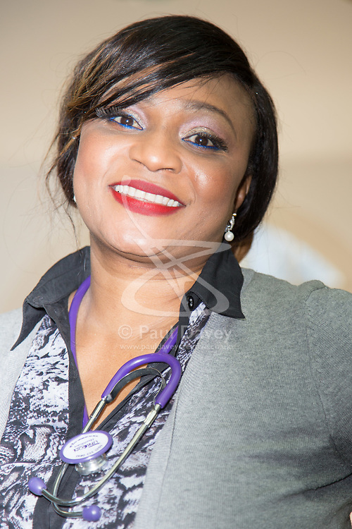 DAILY EXPRESS. Nurse Suzan Owenama at the Unison headquarters in London on the day that the latest NHS pay offer for all staff aside from doctors and dentists is revealed with increases between 6.5 and 29% . London, March 21 2018.