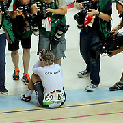Track Cycling - Olympics: Day 11  Kristina Vogel of Germany lays on the track surrounded by photographers after winning the gold medal in the Women's Sprint Final during the track cycling competition at the Rio Olympic Velodrome August 16, 2016 in Rio de Janeiro, Brazil. (Photo by Tim Clayton/Corbis via Getty Images)