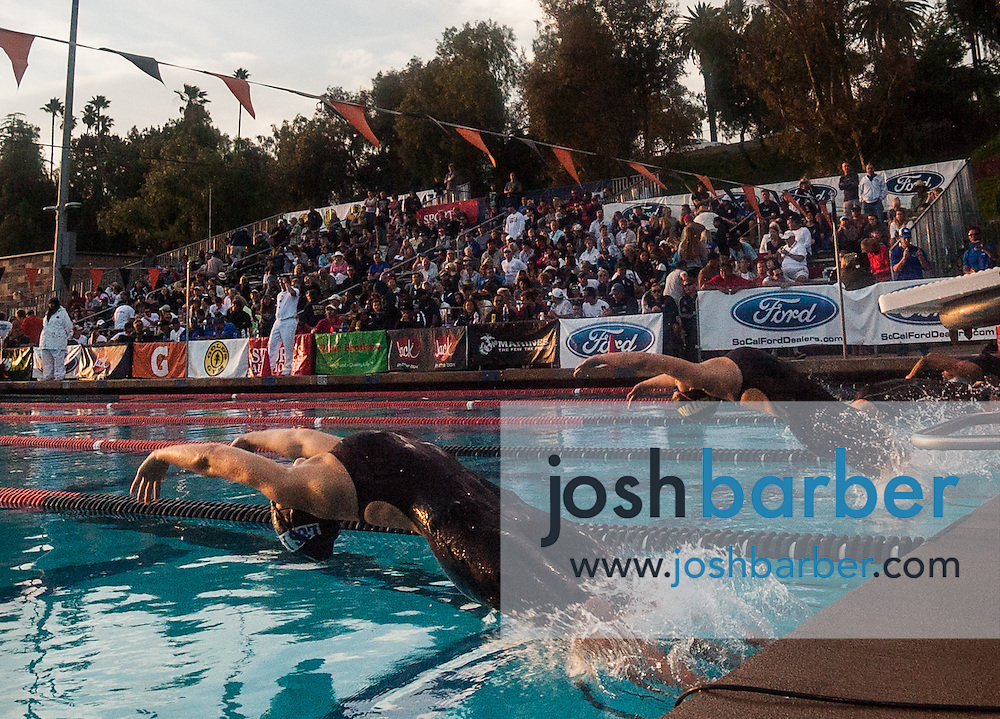 Swimmers compete in the girls 100-yard backstroke during the CIF-SS Division 1 Swimming Finals at Riverside City College on Saturday.<br /> z