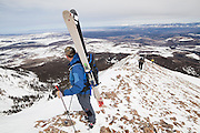 Backcountry skiers ascend the summit ridge of Hayden Peak, San Juan Mountains, Colorado.
