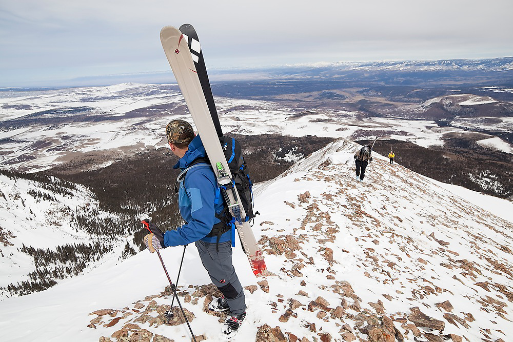 Backcountry skiers ascend the summit ridge of Hayden Peak, San Juan Mountains, Colorado.