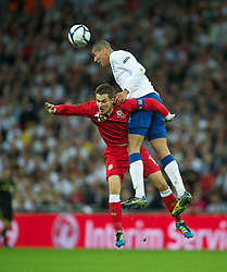 06.09.2011, Wembley Stadium, London, GBR, UEFA EURO 2012, Qualifikation, England vs Wales, im Bild Wales' captain Aaron Ramsey in action against England's Chris Smalling during the UEFA Euro 2012 Qualifying Group G match at Wembley Stadium on 6/9/2011. EXPA Pictures © 2011, PhotoCredit: EXPA/ Propaganda Photo/ David Rawcliff +++++ ATTENTION - OUT OF ENGLAND/GBR+++++
