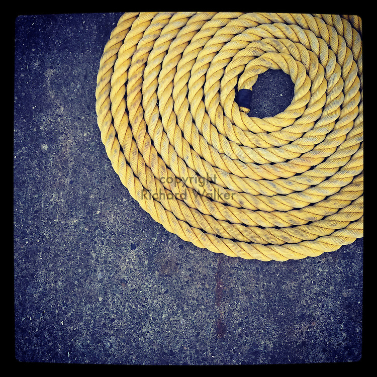 2015 JULY 07 - Coiled rope at a harbor pier in Seattle, WA, USA. Taken/edited with Instagram App for iPhone. By Richard Walker