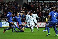 Swansea city's Jonathan De Guzman © watches as his shot goes wide of goal.  Barclays Premier league, Swansea city v Chelsea at the Liberty Stadium in Swansea, Swansea, South Wales on Saturday 3rd November 2012. pic by Andrew Orchard, Andrew Orchard sports photography,