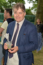 The EARL OF CARNARVON at the Flannels For Heroes cricket competition in association with Dockers held at Burton Court, Chelsea, London on 19th June 2015