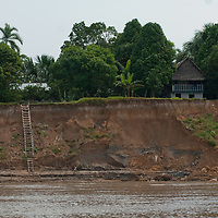 Stairs lead up a mud cliff from the Amazon River to huts that will be close to waterline during flood season.