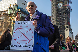London, UK. 17th November, 2018. Author, ecologist and green lifestyle coach Donnachadh McCarthy joins environmental campaigners from Extinction Rebellion on Westminster Bridge, one of five bridges blocked in central London, as part of a Rebellion Day event to highlight 'criminal inaction in the face of climate change catastrophe and ecological collapse' by the UK Government as part of a programme of civil disobedience during which scores of campaigners have been arrested.