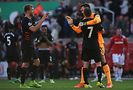 Liverpool's Simon Mignolet, Ragnar Kloven and James Milner celebrate their win at the end of the game. Premier league match, Stoke City v Liverpool at the Bet365 Stadium in Stoke on Trent, Staffs on Saturday 8th April 2017.<br /> pic by Bradley Collyer, Andrew Orchard sports photography.
