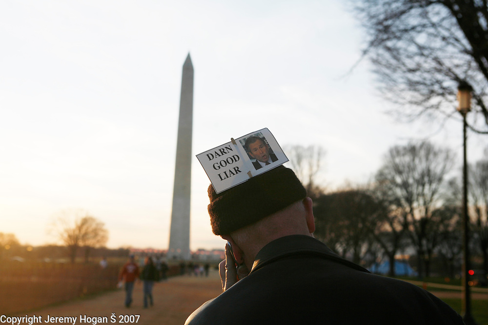 A protester still wearing his sign on his hat calls it a day. Over 100,000 anti-war protesters gathered on the Washington Mall and then marched on a route around the U.S. Capitol.