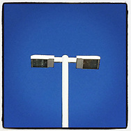2018 JANUARY 25 - Lamp and post against a blue summer sky in West Seattle, WA, USA. Taken/edited with Instagram App for iPhone. By Richard Walker