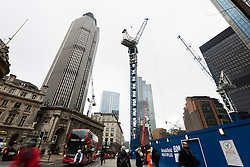 "© Licensed to London News Pictures. 10/03/2016. London, UK. Construction at the site of 22 Bishopsgate (right) and Tower 42 (left) in London. If completed, the 62-storey, 295 meter glass and steel tower would become the City of London's tallest ever skyscraper, standing three times the height of Big Ben. But the scheme is under threat following ""right-to-light"" legal discussions with local residents, heritage groups and the owners of neighbouring properties including Tower 42, the Baltic Exchange and St Helen's church. Photo credit : Vickie Flores/LNP"