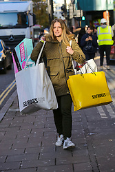 © Licensed to London News Pictures. 29/11/2019. London, UK. A shopper with number of shopping bags on Oxford Street as she took advantage of Black Friday Sale Event.   Photo credit: Dinendra Haria/LNP