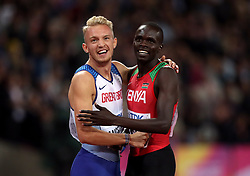 Great Britain's Kyle Langford and Kenya's Kipyegon Bett after the Men's 800m Final during day five of the 2017 IAAF World Championships at the London Stadium.