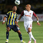 S.B. Elazigspor's player Julien Faubert (R) and Fenerbahce's player Selcuk Sahin (L) are in action with ball during their Turkish superleague soccer match S.B. Elazigspor between Fenerbahce at the Ataturk stadium in izmir Turkey on Saturday 18 August 2012. Photo by TURKPIX