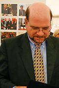 US ambassador to Kosovo Christopher Dell is seen in a food market in Downton capital Prishtina in Kosovo, Sept 18, 2009. (Photo/ Vudi Xhymshiti)