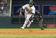 Oakland Athletics 2nd baseman Jemile Weeks flips the ball to 1st base to make an out against the Minnesota Twins on July 13, 2012 at Target Field in Minneapolis, Minnesota.  The Athletics defeated the Twins 6 to 3.  © 2012 Ben Krause