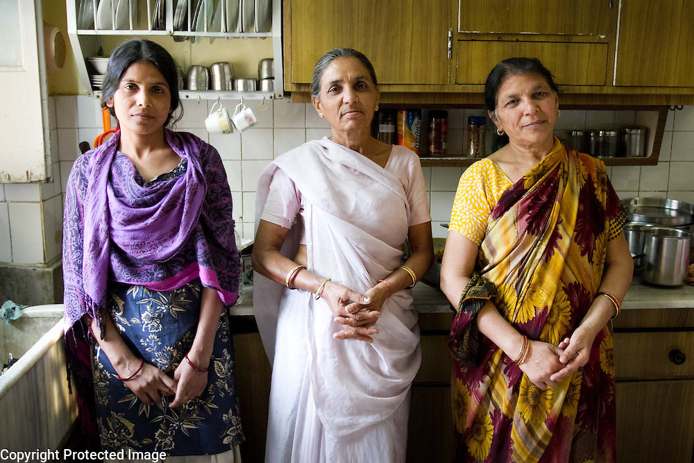 Three woman in the kitchen, India. Photography by Debbie Zimelman, Modiin, Israel
