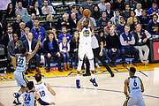 Golden State Warriors forward Kevin Durant (35) shoots a three pointer against the Memphis Grizzlies at Oracle Arena in Oakland, Calif., on December 20, 2017. (Stan Olszewski/Special to S.F. Examiner)