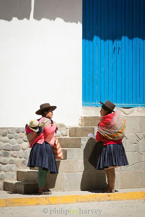 Locals with children on back in Paucartambo, Cusco Region, Peru, South America