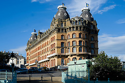 Scarborough Grand Hotel is a Grade II listed building Dominating the the town's South Bay. When completed in 1867 it was one of the largest hotels in the world, as well as one of the first giant purpose-built hotels in Europe. The hotel is in the shape of a 'V' in honour of Queen Victoria and was designed around the theme of time: <br /> 4 towers to represent the seasons, <br /> 12 floors for the months of the year, <br /> 52 chimneys symbolise the weeks, <br /> originally there were 365 bedrooms - one for each day of the year. <br /> As Scarborough was a famous 'Spa Town' in its heyday the Grand hotels baths included an extra pair of taps so guests could wash in seawater as well as fresh water.<br /> The hotel was badly damaged when the German Navy bombarded the town in 1914.<br /> Three blue plaques outside mark where the novelist Anne Brontë died in 1849, the contribution of the RAF trainees stationed at the hotel during the Second World War, and the original opening of the building.<br />  12 September 2015<br />  Copyright Paul David Drabble<br />  www.pauldaviddrabble.photoshelter.comom