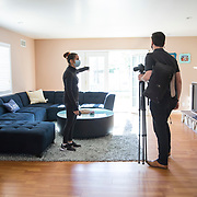 Almost 10 months since her life was thrown in turmoil by the coronavirus in March, 2020, Erin is selling her home and moving into a new home with her boyfriend. It's bitter sweet but she's looking forward to a new chapter in life, she said. A sales agent and his team photograph and discuss a marketing strategy.
