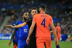31 August 2017 -  FIFA World Cup Qualifying (Group A) - France v Netherlands - The Referee intervenes as Alexandre Lacazette of France clashes with Wesley Hoedt of Netherlands - Photo: Marc Atkins/Offside