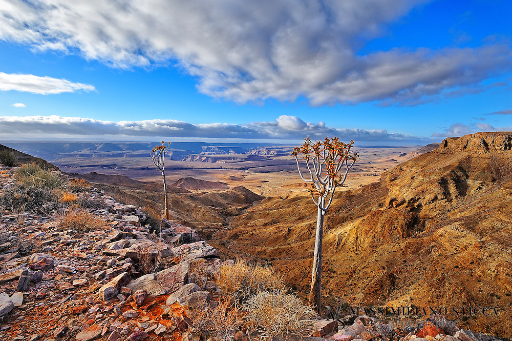 The Fish River Canyon is located in the south of Namibia. It is the second largest canyon in the world[2] and the largest in Africa, as well as the second most visited tourist attraction in Namibia.[3] It features a gigantic ravine, in total about 100 miles (160 km) long, up to 27 km wide and in places almost 550 metres deep.....The Fish River is the longest interior river in Namibia. It cuts deep into the plateau which is today dry, stony and sparsely covered with hardy drought-resistant plants. The river flows intermittently, usually flooding in late summer; the rest of the year it becomes a chain of long narrow pools. At the lower end of the Fish River Canyon, the hot springs resort of Ai-Ais is situated.....Public view points are near Hobas, a camp site 70 km north of Ai-Ais. This part of the canyon is part of the Ai-Ais/Richtersveld Transfrontier Park. The other 90 km of this canyon are privately owned.
