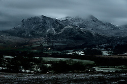 © Licensed to London News Pictures. 21/01/2019. Dolgellau, Gwynedd, Wales, UK. A wintry landscape is seen lit by moonlight near Dolgellau, Gwynedd, Snowdonia National Park, after a fresh snowfall on Monday evening 21st January 2019. UK. credit: Graham M. Lawrence/LNP