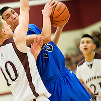 030113  Adron Gardner/Independent<br /> <br /> Navajo Pine Warrior Colin Tompson (33) looks for a shot around Ramah Mustang  Sean Jordan (10) during the 1-2A district final in Ramah March, 2.