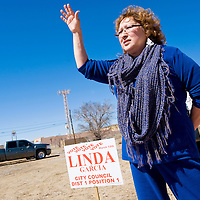 031213       Cable Hoover<br /> <br /> District 1 city council candidate Linda Garcia waves to passing traffic while campaigning outside the polling station at the 9th Street fire station Tuesday in Gallup.