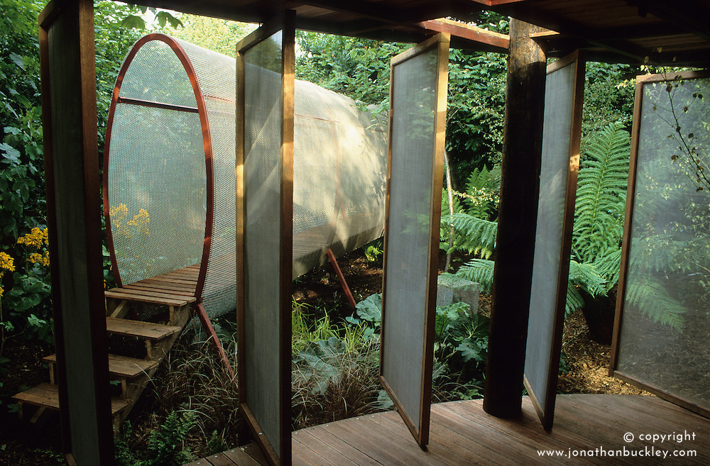 Room at the end of the garden with swivelling wire mesh doors.