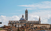 Siena's old town with red rooftops, and the ancient clocktower and cathedral. Siena, Tuscany, Italy