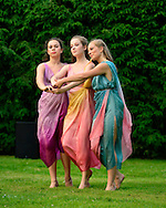 Old Westbury, New York, U.S. 22nd June 2013. Dancers in Lori Belilove & The Isadora Duncan Dance Company, perform a dance of the Three Graces, at the Midsummer Night event at Old Westbury Gardens, throughout the illuminated grounds of the historic Long Island Gold Coast estate.<br /> The Three Graces, or Three Charities, of Greek mythology were Aglaia, Euphrosyne, and Thalia - goddesses of beauty, joy, harmony, pleasure, grace, festivity, adornment, dance, and song. Daughters of Zeus and sea-nymph Eurynome, they were also the attendants, or handmaidens, of Aphrodite and Hera and protectors of vegetation.