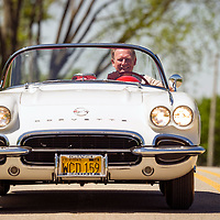 Bill Ogden drives his 1962 Corvette on a rural road in McHenry County